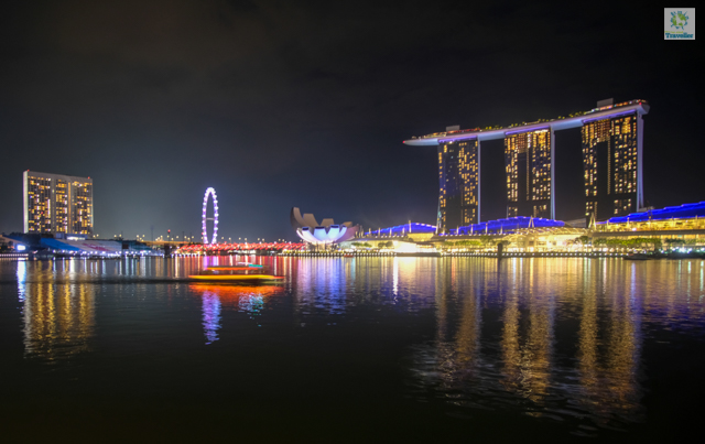 A bumboat cruising towards Marina Bay Sands.